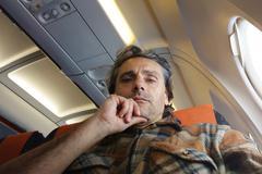 flight traveler - stock photo
