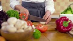 Chef chopping mushroom slow motion Stock Footage