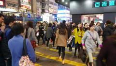 Walking in the crowd on the night street of Hong Kong city, pedestrian crosswalk Stock Footage
