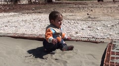 Toddle in sandpit Stock Footage