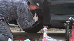 Mechanic Doing A Brake Job On An E39 Bmw 540I - stock footage