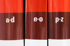 encyclopedia books in row - stock photo