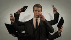 Handsome young businessman multitasking and busy with multiple arms Stock Footage