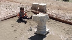 Toddle in sandpit and gypsum column Stock Footage