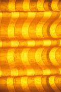 Warm tone blinds or curtains and abstract natural sunlight - stock photo