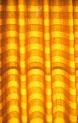 Warm tone blinds or curtains and abstract natural sunlight Stock Photos