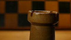 Chess rook revolves around against the background of the board Stock Footage