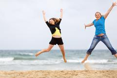 Women jump - stock photo
