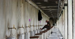 Man taking ablution in front of the Sultanahmet Mosque Stock Footage