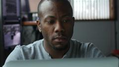 African American man working on a laptop at work Stock Footage