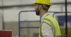 Manufacturing staff in a production factory. Stock Footage