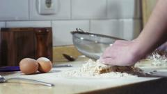 Feminine hands adding milk into dough - stock footage