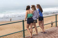 Girls  Holidays Beach Railing - stock photo