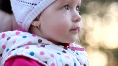 Funny little child girl grimace face - stock footage