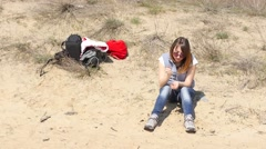 Girl tourist rest sitting on sand in desert steppe zone Stock Footage