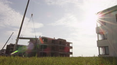 Crane is Lifting Building Materials on Construction - stock footage