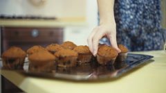 Stock Video Footage of Feminine hands put cakes on the tray, rack focus, close up