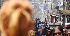 People crowd in the Istiklal Caddesi in Istanbul Stock Footage