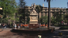People walk by Plaza de Armas in Santiago, Chile. Stock Footage