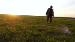 Older farmer checking on grain fields in early winter Stock Footage