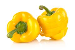 Close up view of slices yellow bell peppers isolated on white background - stock photo