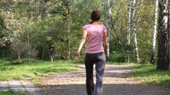 MOSCOW, RUSSIA - 2012: Young people jogging in the park Stock Footage