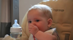 PEOPLE. CHiLDREN-2012: Baby eat with a spoon. Close-up Stock Footage