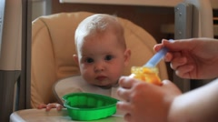 PEOPLE. CHiLDREN-2012: Baby eat with a spoon Stock Footage