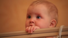 PEOPLE. CHiLDREN-2012: Baby standing in the bed. Face close-up Stock Footage