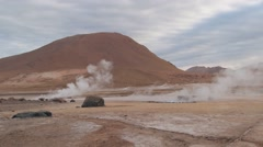 El Tatio geysers steam at sunrise at the famous El Tatio geyser valley,  Chile. - stock footage