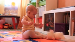PEOPLE. CHiLDREN-2012: Small baby playing dools on the floor Stock Footage