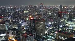 Time Lapse of Tsukiji Fish Market District at night in Tokyo, Japan -Pan Right- Stock Footage