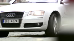 Outstanding Audi A8 L, White Audi Exclusive Limousine driving in city center Stock Footage