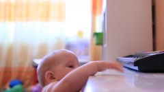 PEOPLE. CHILDREN-2012: Small baby tries to climb Stock Footage