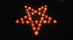 Many candles arranged into the gothic pentagram symbol Stock Footage
