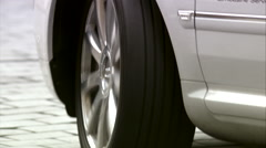 Close up of a silver wheel/Audi Exclusive Limousine parking - stock footage