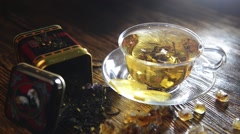 Tea composition on a wooden background Stock Footage