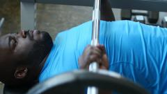 Man Exercising, Doing the Bench Press in the Gym, Close Shot Stock Footage