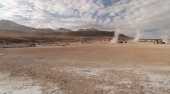 El Tatio geysers steam at sunrise at the famous El Tatio geyser valley,  Chile. Stock Footage