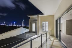 Balcony exterior of mansion with night views of skyline Stock Photos