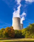 Cooling towers spew clouds into the atmosphere - stock photo
