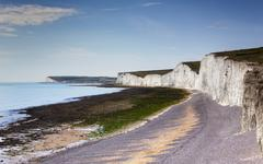 White Chalk Cliffs and shible beaches at the the Seven Sisters, Birling Gap Stock Photos