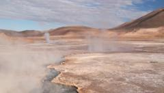 Thermal water spring produces hot steam at the El Tatio geyser valley, Chile. Stock Footage