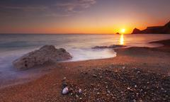 Serene South Dorset Beach and Sea at Sunset - stock photo
