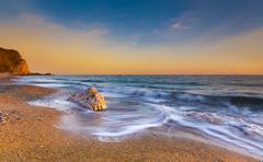 Serene South Dorset Beach and Sea at Sunset Stock Photos