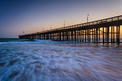 Waves in the Pacific Ocean and the pier at sunset, in Ventura, California. - stock photo