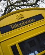 Yellow Guernsey Phone Boxes - stock photo