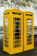 Stock Photo of Yellow Guernsey Phone Boxes