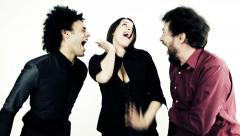 Happy woman dancing between two cool men Arkistovideo