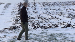 Young farmer checking on wheat in winter Stock Footage